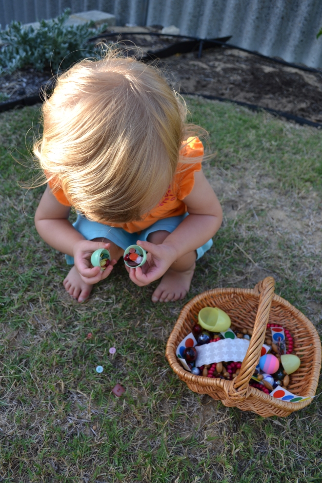 Examining the spoils of an Easter egg hunt