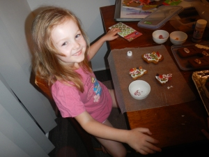 Eden decorating cookies